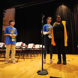 Aaron Chang (left) from the Audubon Elementary School and Maya Joshi(center) from the Young Magnet High School with Paschel Bennett, Academic Competitions Coordinator, during award ceremony of the annual Citywide Spelling Bee Championship at the Lindblom Math and Science Academy on March 14, 2019. Aaron Chang, winner of the contest, will represent Chicago Public Schools at the Scripps National Spelling Bee in Washington, D.C., where he will compete against the best spellers from across the nation for the title of 2019 national Spelling Bee Champion and an opportunity to win a $40,000 prize. | Victor Hilitski/For the Sun-Times