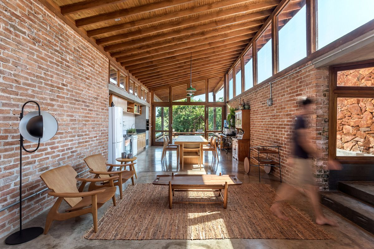 Open-plan living room with brick walls