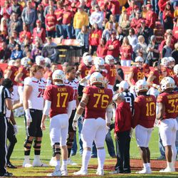 Iowa State's captains: Kyle Kempt (17), Ray Lima (76), Brian Peavy (10) and David Montgomery (32) meet the captains of Texas Tech. Those captains (left to right) are Ja'Deion High (88), Jah'shawn Johnson (7), Travis Bruffy (79) and Terence Steele (78).