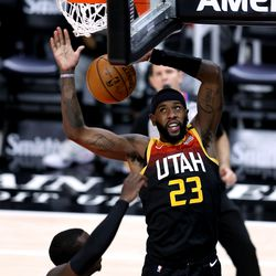 Utah Jazz forward Royce O'Neale (23) goes in for a dunk and is fouled by Miami Heat guard Kendrick Nunn (25) as the Utah Jazz and the Miami Heat play an NBA basketball game at Vivint Smart Home Arena in Salt Lake City on Saturday, Feb. 13, 2021. Utah won 112-94.