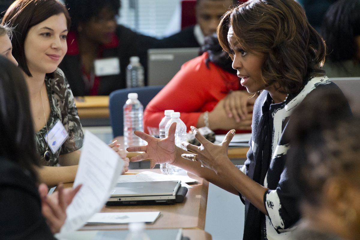 First Lady Michelle Obama talks with students, parents and counselors as they fill out the FAFSA (Free Application for Federal Student Aid) during a FAFSA workshop in February.