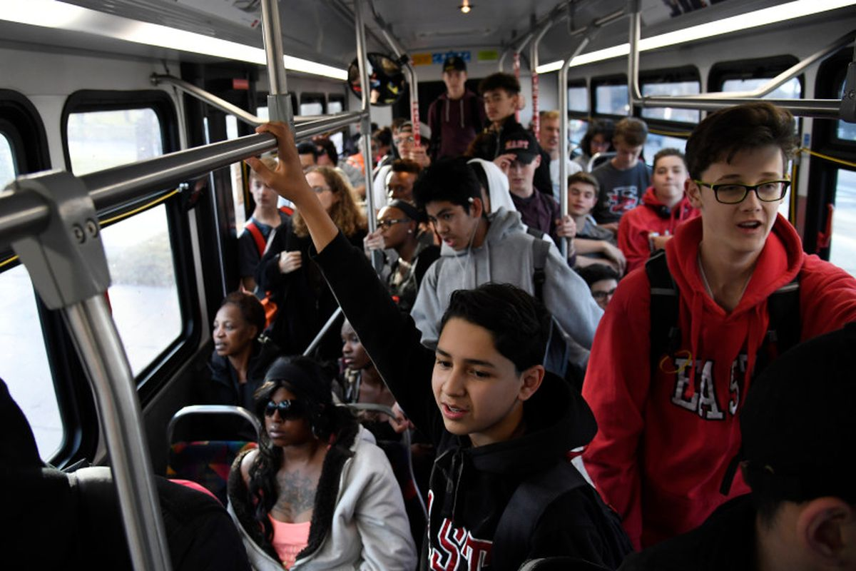 East High School freshman Marcos Chavez, center, hangs onto a handrail on an RTD bus on his way home from school in 2017.