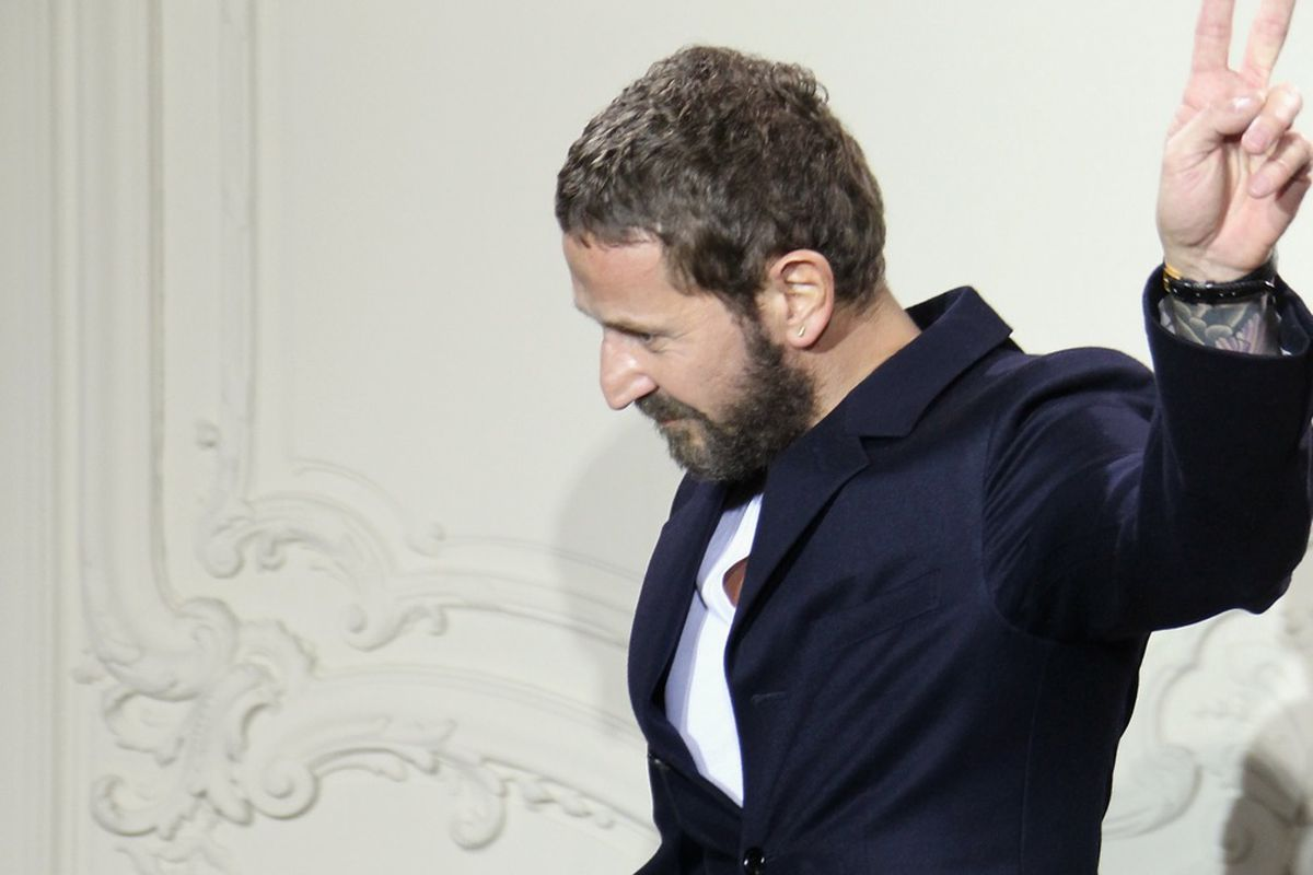 Stefano Pilati's graceful exit from his last show at Yves Saint Laurent in 2011. Via Getty