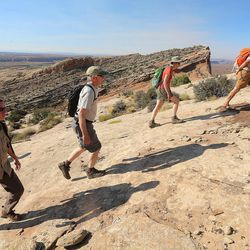 Interior Secretary Sally Jewell hikes with other federal and local BLM and forestry officials toward Comb Ridge as she visits rock art sites, some of witch have been vandalized in southern Utah on Saturday, July 16, 2016.