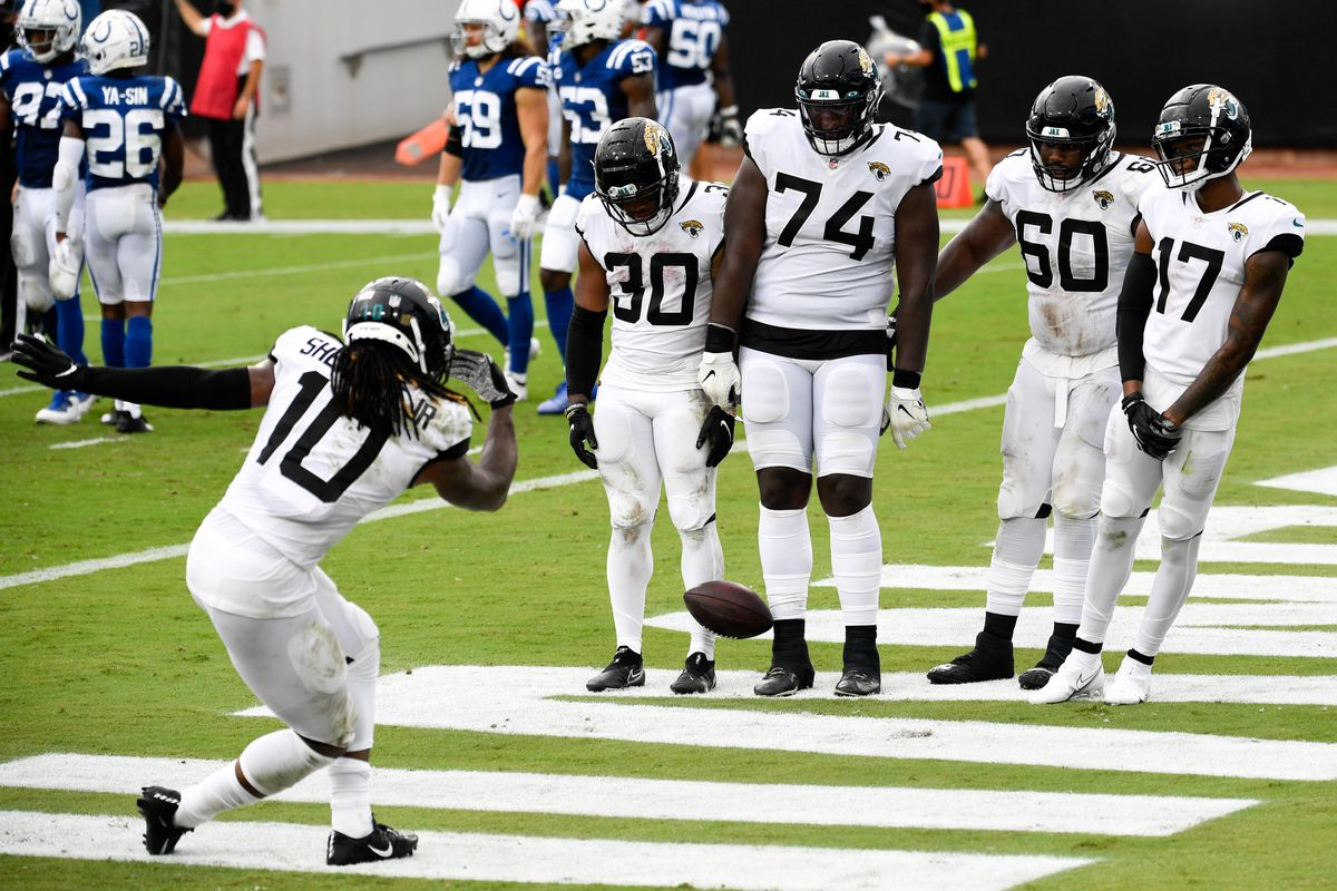 Jacksonville Jaguars wide receiver Laviska Shenault Jr. (10) celebrates with teammates running back James Robinson (30) offensive tackle Cam Robinson (74) guard A.J. Cann (60) and wide receiver DJ Chark Jr. (17) after scoring a touchdown during the second quarter against the Indianapolis Colts