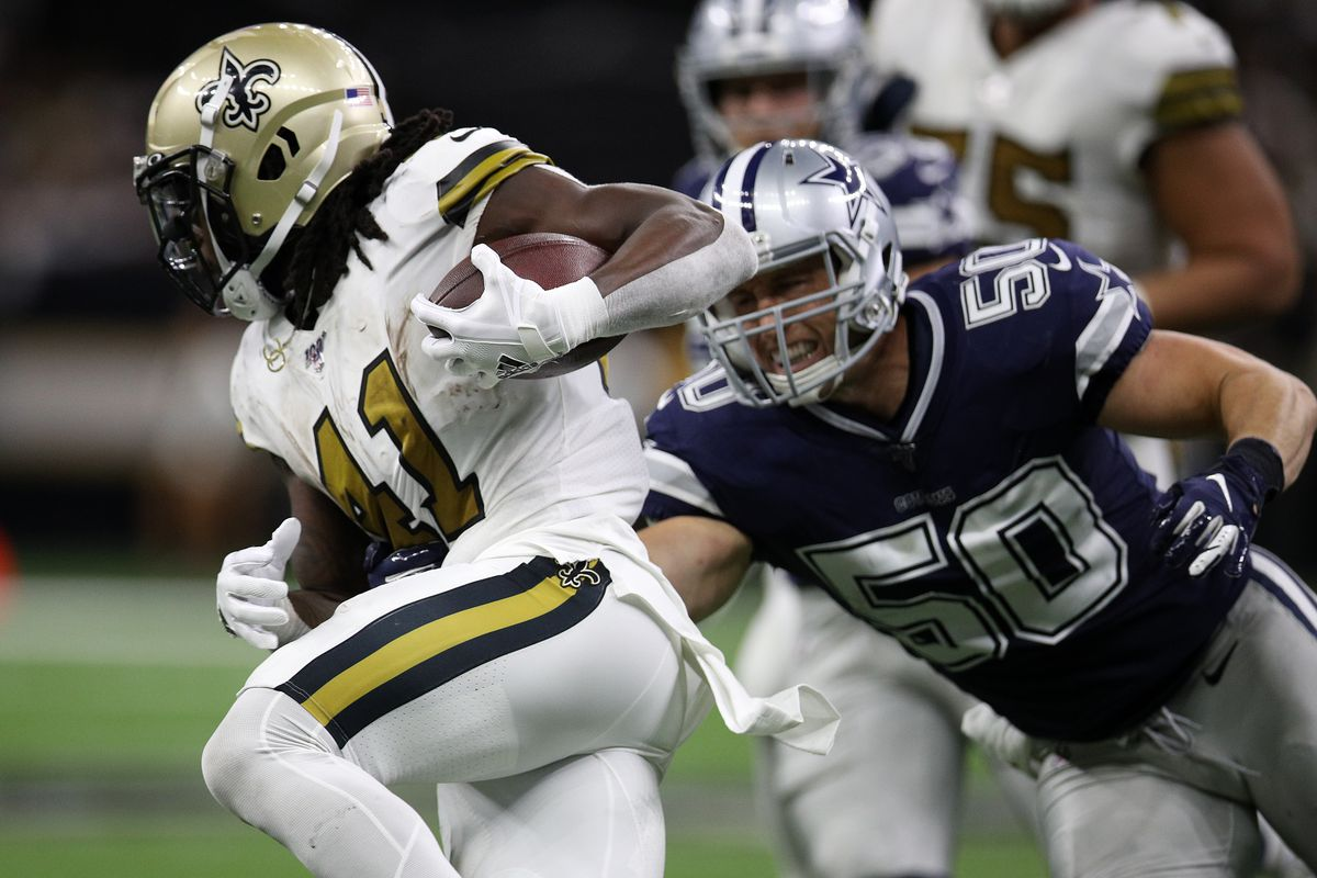 Alvin Kamara of the New Orleans Saints is tackled by Sean Lee of the Dallas Cowboys at the Mercedes Benz Superdome on September 29, 2019 in New Orleans, Louisiana.