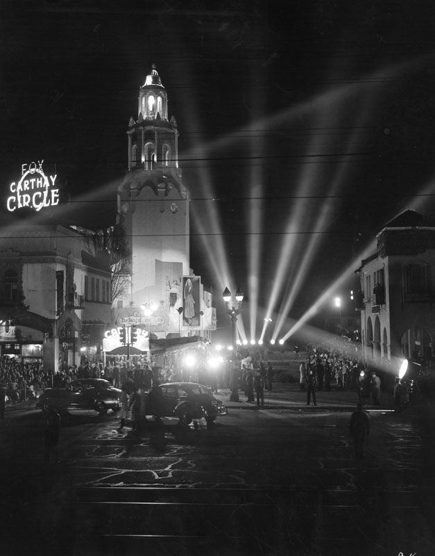 Searchlights surround the Carthay Circle Theater for a movie premiere.