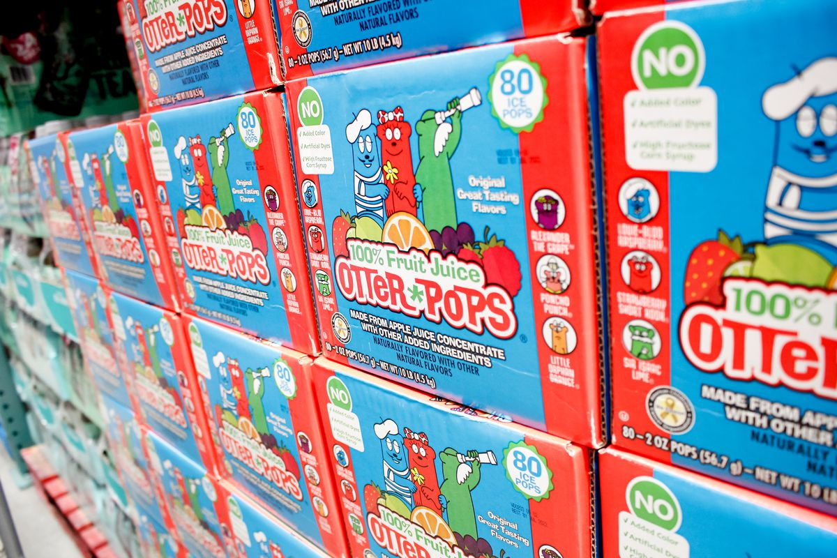 """A shelf of red and blue boxes reading """"otter pops"""""""