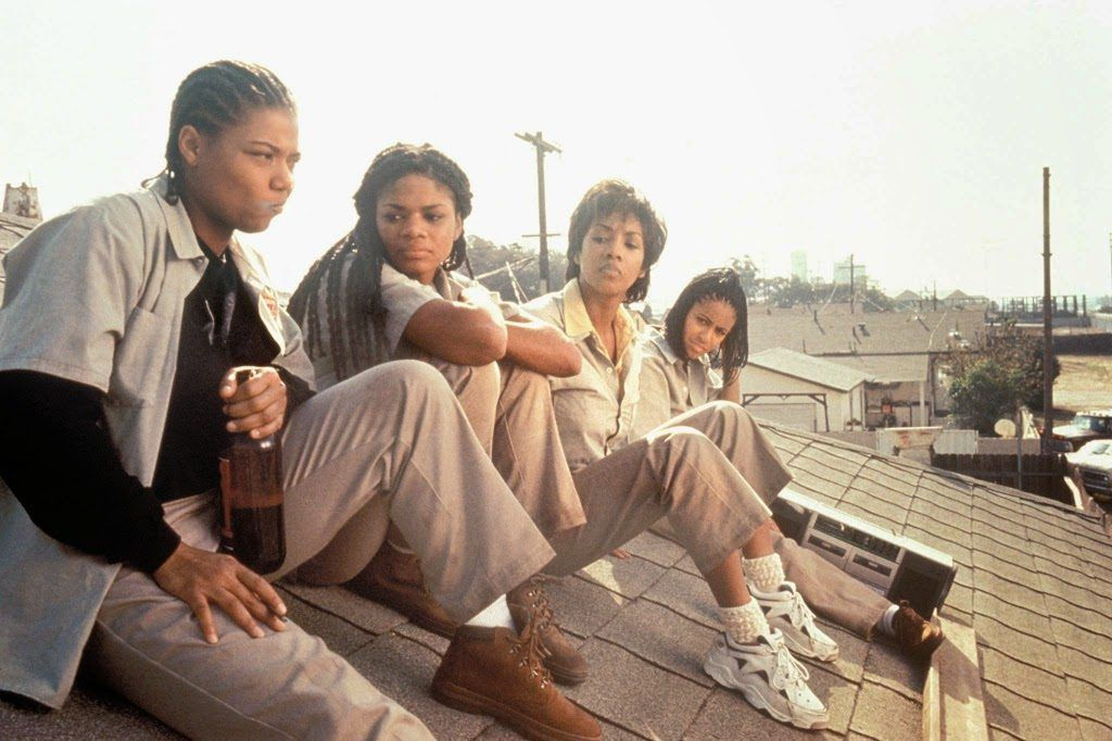 Four people sitting on the roof of a house in 'Set It Off'