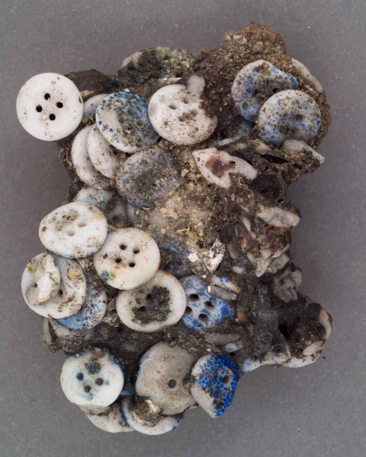 A clump of blue and white pearl clothing buttons fused together with mortar during the Great Chicago Fire in 1871.