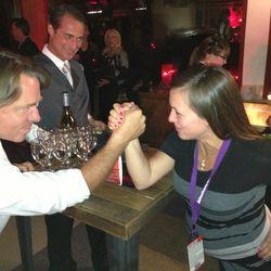 John Besh arm wrestles Eater Denver editor Andra Zepellin. [Photo courtesy Andra Zepellin]