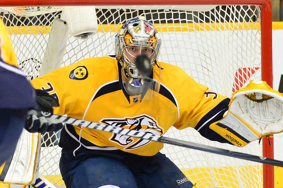 Apr 11, 2012; Nashville, TN, USA; Nashville Predators goalie Pekka Rinne (35) watches an incoming shot against the Detroit Red Wings during the 2012 Western Conference quarterfinals at Bridgestone Arena. Mandatory Credit: Don McPeak-US PRESSWIRE