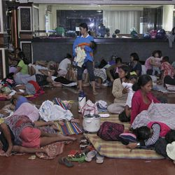 Residents take shelter at the lobby of the city hall in Tandag, Surigao Del Sur province in southern Philippines, following a 7.6 magnitude earthquake that struck eastern and southern Philippines Friday, Aug. 31, 2012. The quake set off car alarms, shook items off shelves and sent many coastal residents fleeing for high ground before the Pacific Tsunami Warning Center lifted all tsunami alerts it had issued for the Philippines and neighboring countries from Indonesia to Japan, and for Pacific islands as far away as the Northern Marianas.