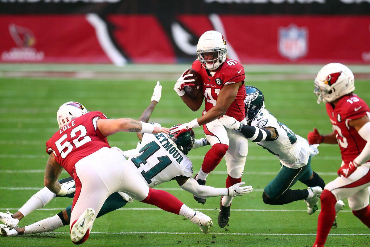 Arizona Cardinals running back Kenyan Drake (41) runs the ball against the Philadelphia Eagles during the first half at State Farm Stadium.