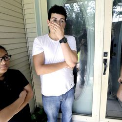 Neighbors of the shooting victims, from left, Viri Palacios, her brother Miguel and sister Anamari talk about the shooting deaths that occurred across the street from their home Thursday, July 10, 2014, in Spring, Texas. The Harris County Sheriff's Office says Ronald Lee Haskell was booked Thursday on a capital murder/multiple murders charge and held without bond. Authorities believe Haskell fatally shot two adults and four children on Wednesday night and critically wounded a 15-year-old girl, who called 911. (AP Photo/David J. Phillip)