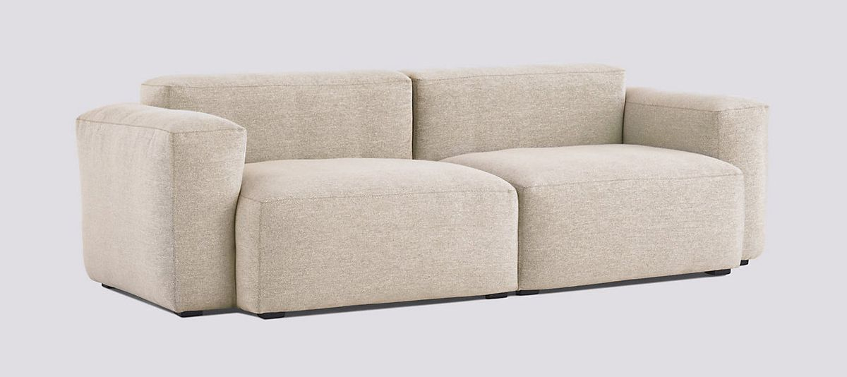 Beige sofa made of rounded, puffy blocks.