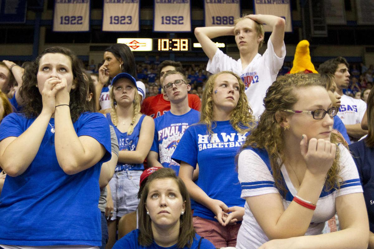 Kansas fans react while watching the closing seconds of the national championship game on the video board at Allen Fieldhouse Monday, April 2, 2012, in Lawrence Kan.  Kentucky beat KAnsas 67-59 to win the NCAA championship.