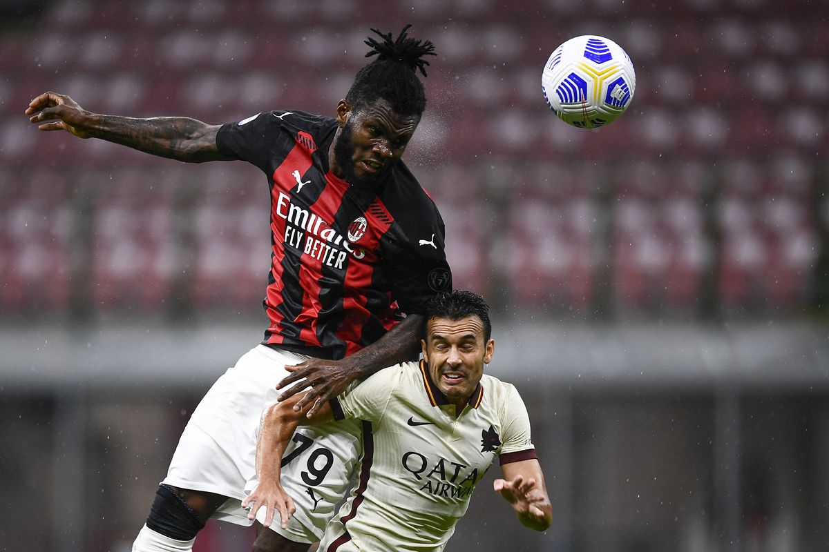 Franck Kessie (L) of AC Milan competes for a header with...