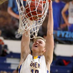 Orem's Taylor Hockersmith dunks the ball during a Vivint Great Western Shootout basketball game against the British Columbia Christian Panthers at Orem High School in Orem on Friday, Dec. 8, 2017. Orem won 63-56.