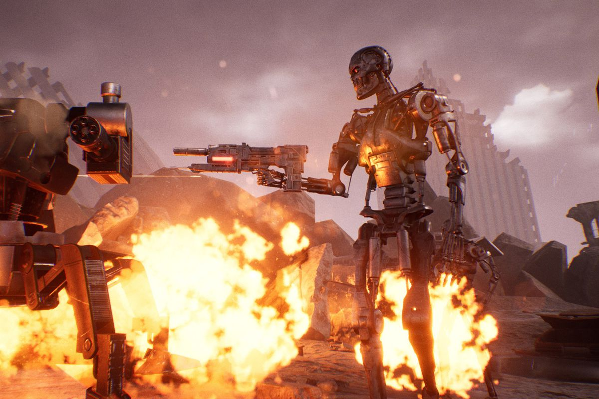 A T-800 stands backlit by a series of explosions.
