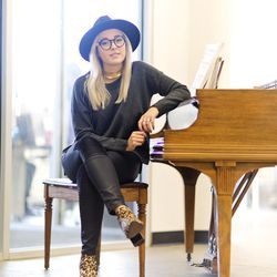 """<b>Bryn Newman</b>, Marketing Manager, wearing a gold choker from Stein Mart, (""""yay being from Florida!""""), Madewell waxed jeans, a French Connection Sweater from Le Tote, pointy leopard Report Signature boots from DSW, a wide brim hat from H&M, and round"""