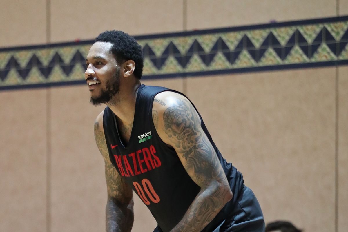 Carmelo Anthony of the Portland Trail Blazers smiles during practice as part of the NBA Restart 2020 on July 14, 2020 in Orlando, Florida.