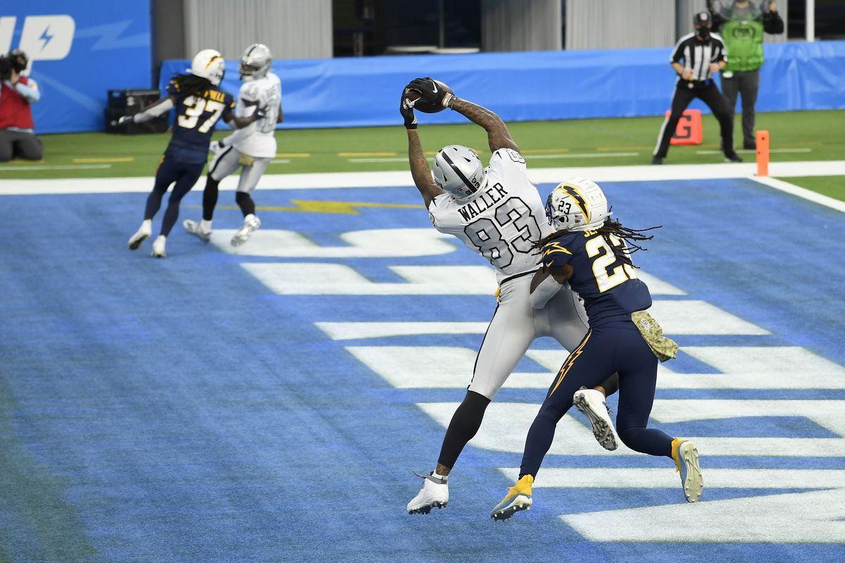 Darren Waller #83 of the Las Vegas Raiders catches a third quarter touchdown in front of Rayshawn Jenkins #23 of the Los Angeles Chargers at SoFi Stadium on November 08, 2020 in Inglewood, California.