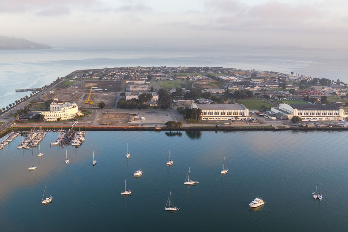 Aerial view from the south of San Francisco's Treasure island showing a small craft harbor, historic buildings, and the San Francisco Bay.