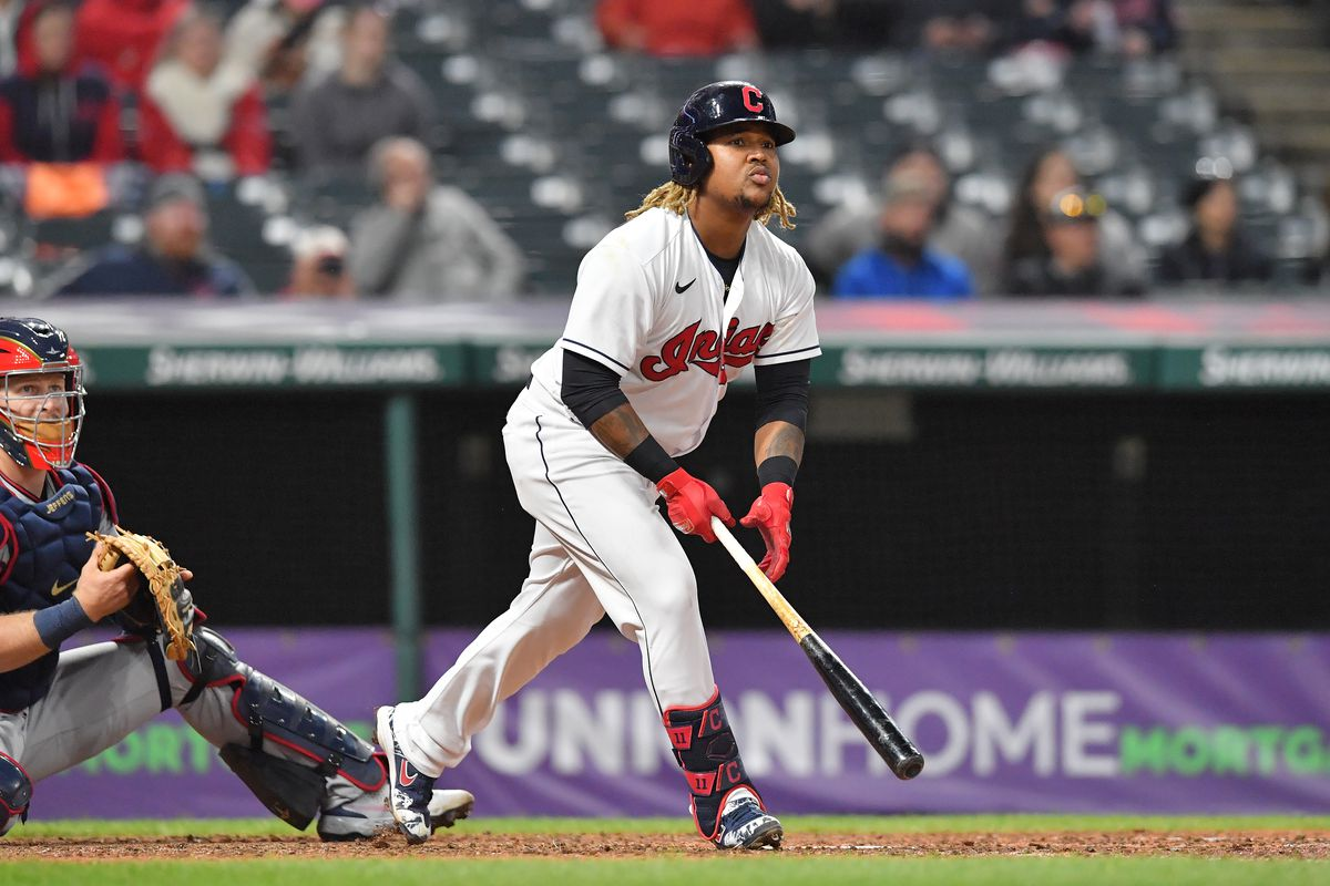 Jose Ramirez #11 of the Cleveland Indians hits a solo home run during the eighth inning against the Minnesota Twins at Progressive Field on April 26, 2021 in Cleveland, Ohio. The Indians defeated the Twins 5-3 in the tenth inning.