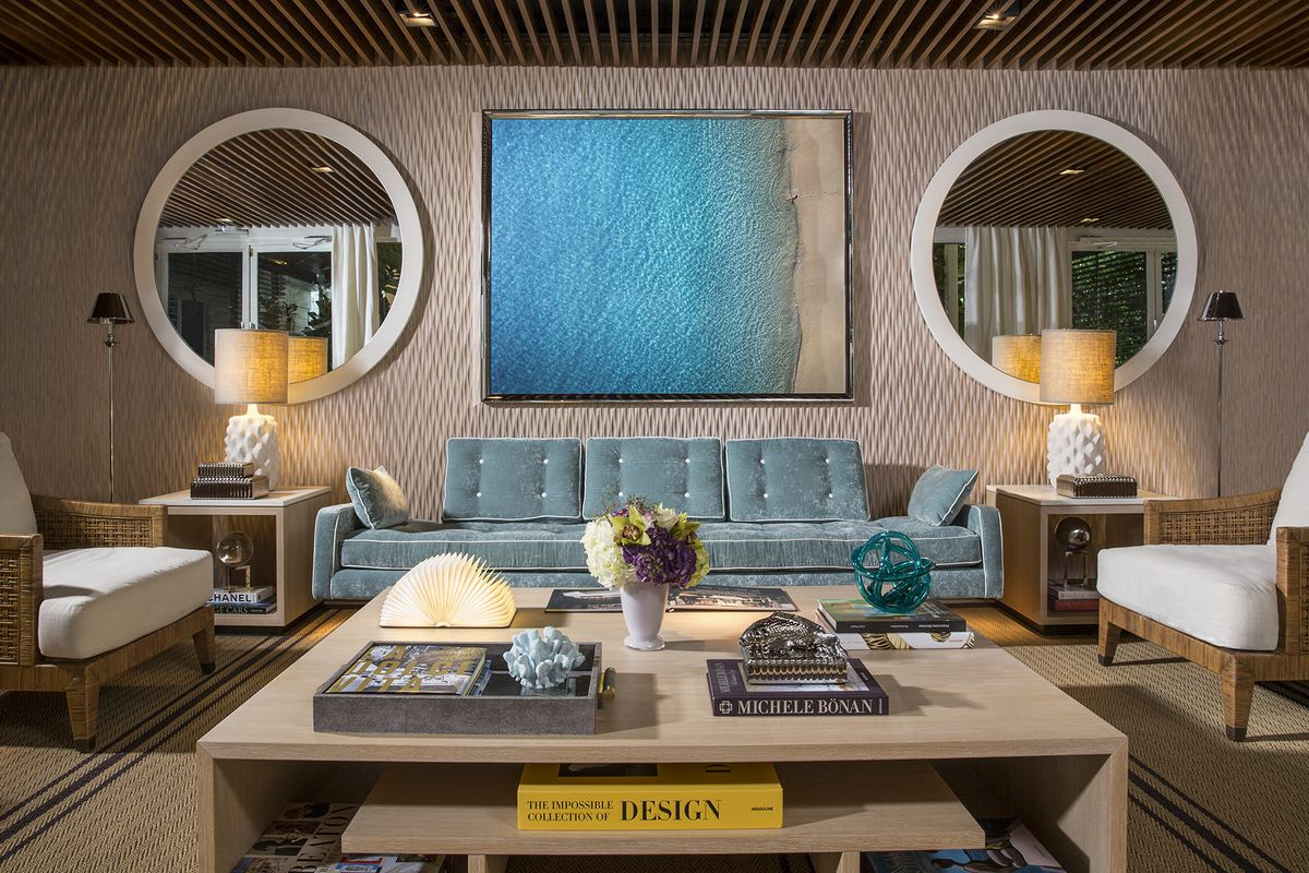 Inside a modern and sophisticated living room at a new development in sunny isles