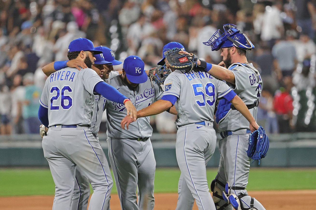 Members of the Kansas City Royals celebrate a win over the Chicago White Sox at Guaranteed Rate Field on August 05, 2021 in Chicago, Illinois. The Royals defeated the White Sox 3-2.