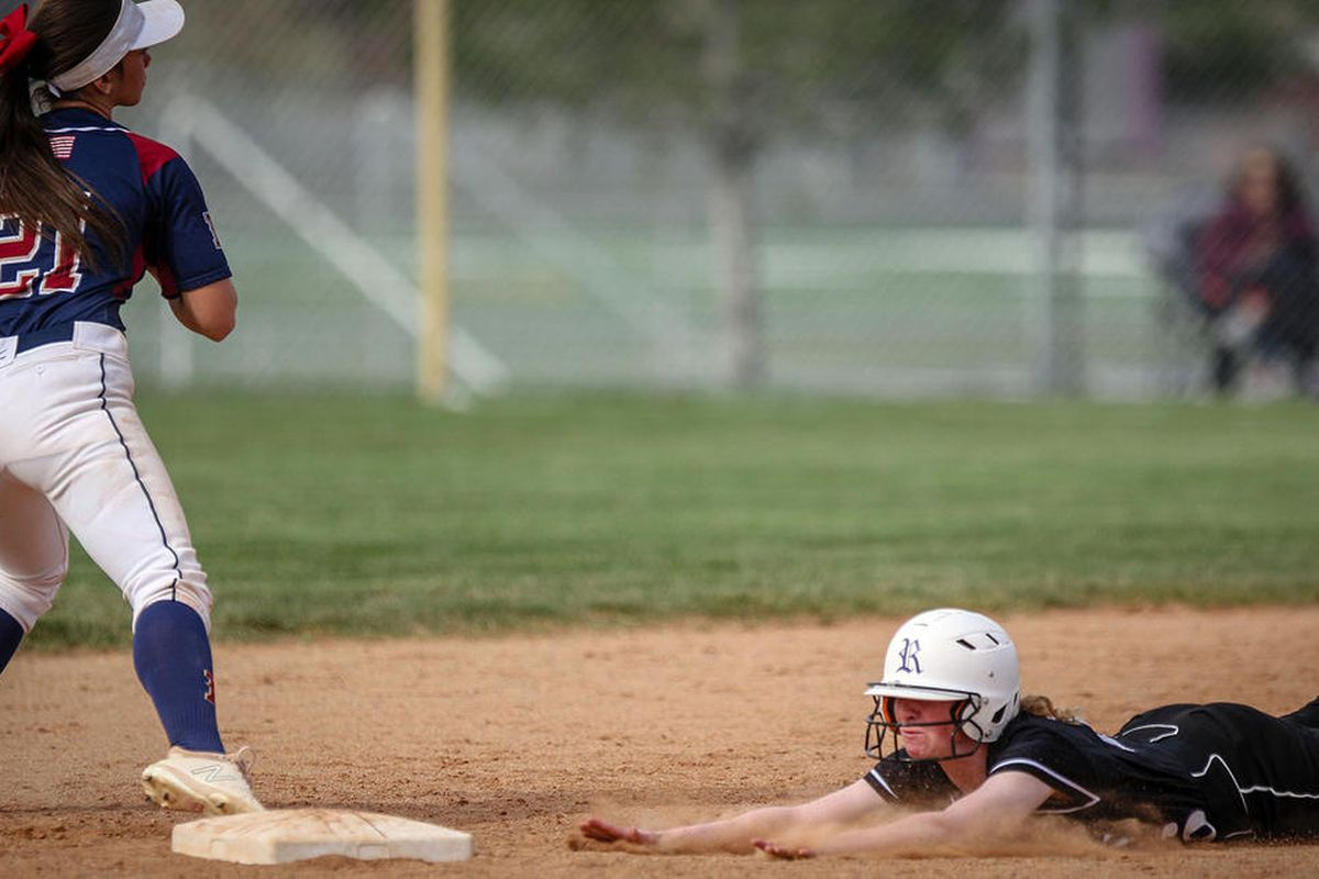 Herriman's April Visser hauls in the ball tagging out Riverton's Clare Heits at second base in the bottom of the third inning as Riverton High hosts Herriman High in softball action on Thursday, April 19, 2018.