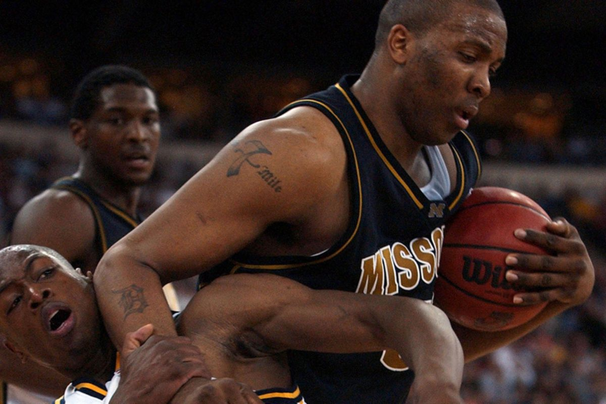 INDIANAPOLIS - MARCH 22: Center Arthur Johnson #50 of Missouri gets tangled up with guard Dwyane Wade #3 of Marquette in the 2nd round of the NCAA Tournament on March 22, 2003 at the RCA Dome in Indianapolis, Indiana.