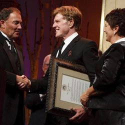 """Gov. Gary Herbert and his wife Jeanette present Robert Redford with the declaration that November 9, 2013 is Robert Redford Day. For all his contributions to the state of Utah, Robert Redford was recognized and honored by Governor Gary Herbert at a gala in his honor, """"The Governor's Salute to Robert Redford: A Utah Tribute to an American Icon"""" at the Grand America Hotel, Saturday, November 9, 2013. Redford is an actor, director, producer, philanthropist, businessman, environmentalist, and founder of the Sundance Resort, the Sundance catalog, and the Sundance Institute which hosts the Sundance Film Festival."""