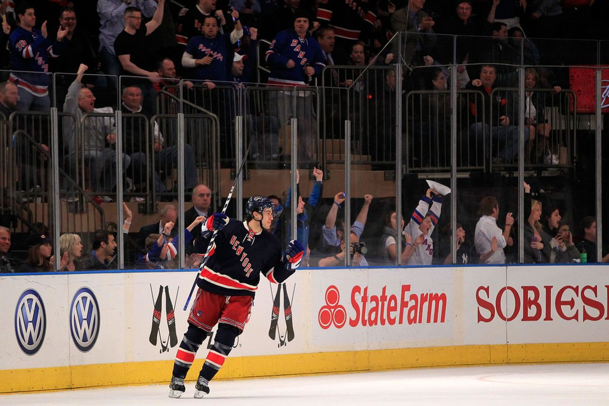 NEW YORK, NY - MARCH 30: Michael Del Zotto #4 of the New York Rangers reacts after scoring a goal in the first period against the Montreal Canadiens at Madison Square Garden on March 30, 2012 in New York City.  (Photo by Chris Trotman/Getty Images)