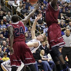 Brigham Young Cougars guard Tyler Haws (3) is defended by Loyola Marymount Lions guard Ayodeji Egbeyemi (24) in Provo  Thursday, Jan. 3, 2013.