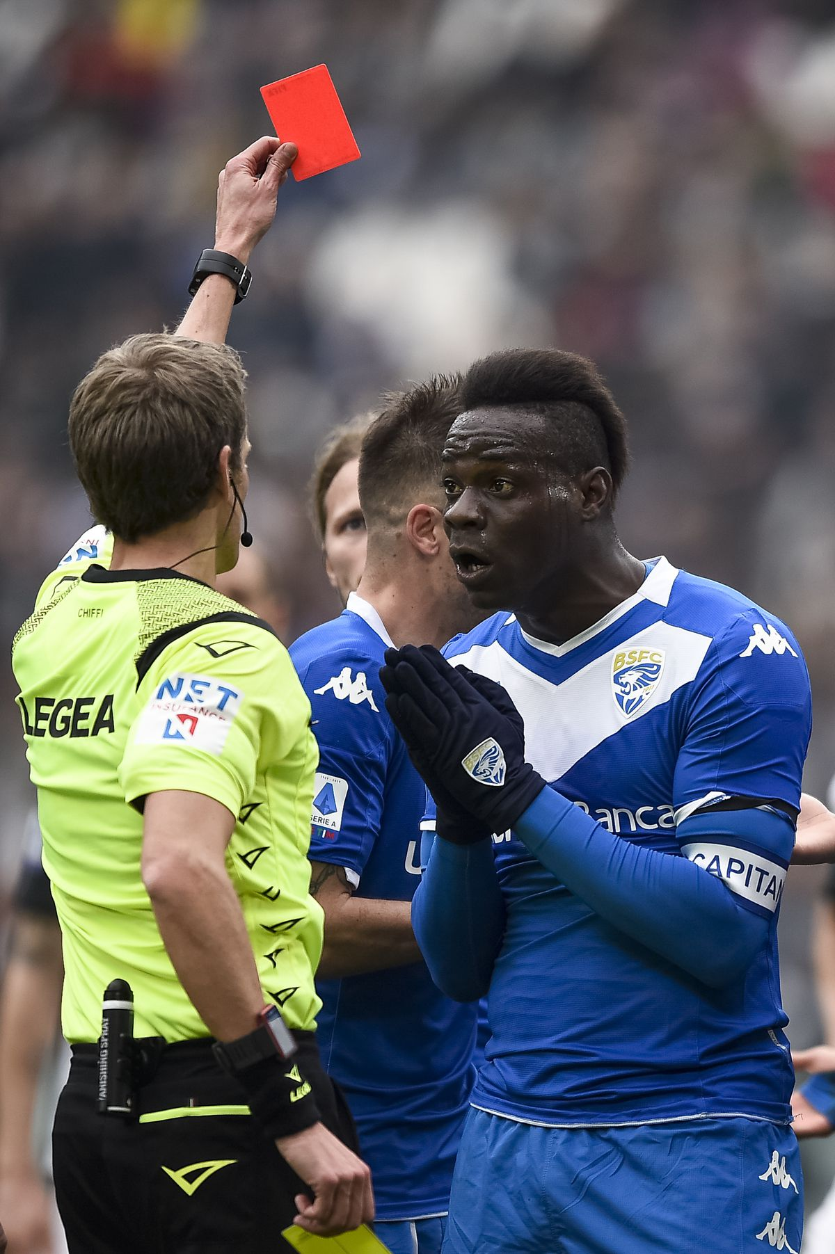 Referee Daniele Chiffi (L) shows red card to Florian Aye (...