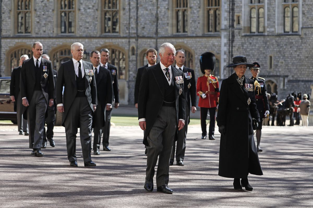 Britain's Prince Charles and Princess Anne (front row), Prince Andrew, Prince Edward (middle row), Prince William (back row), Peter Phillips, Prince Harry, along with David Armstrong-Jones the Earl of Snowdon and Tim Laurence follow the coffin in a ceremonial procession for the funeral of Britain's Prince Philip inside Windsor Castle in Windsor, England Saturday April 17, 2021.