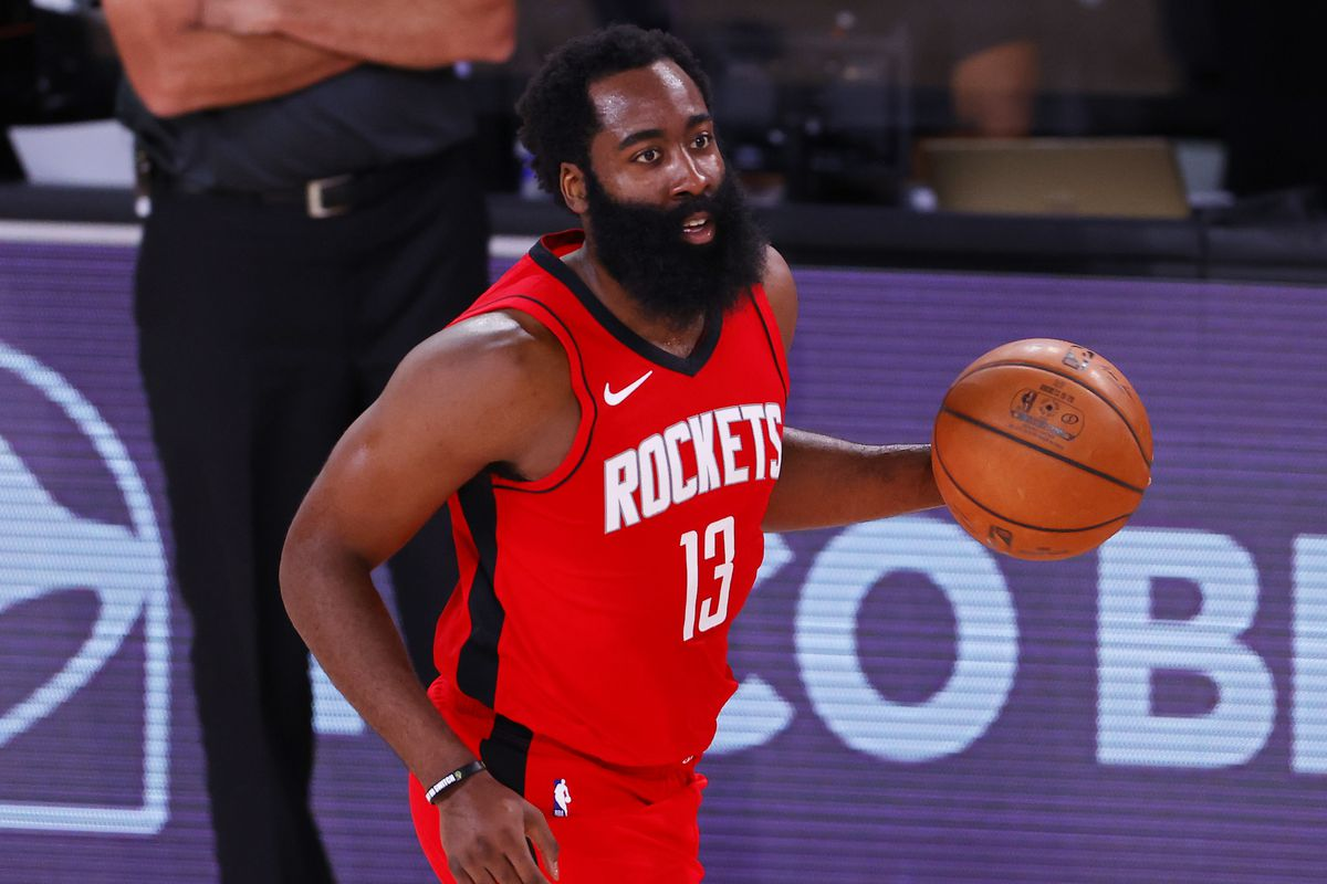 James Harden of the Houston Rockets moves the ball against the Milwaukee Bucks at The Arena at ESPN Wide World Of Sports Complex on August 02, 2020 in Lake Buena Vista, Florida.