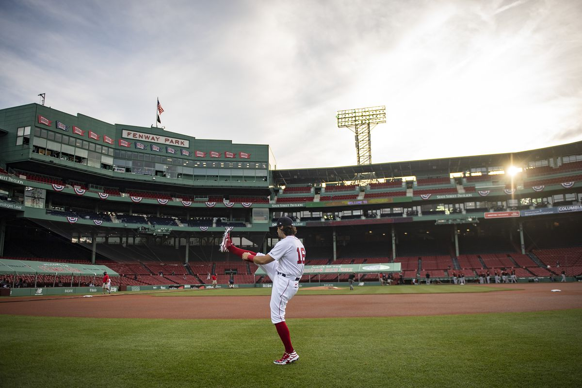 Andrew Benintendi #16 of the Boston Red Sox warms up before the Opening Day game against the Baltimore Orioles on July 24, 2020 at Fenway Park in Boston, Massachusetts. The 2020 season had been postponed since March due to the COVID-19 pandemic.
