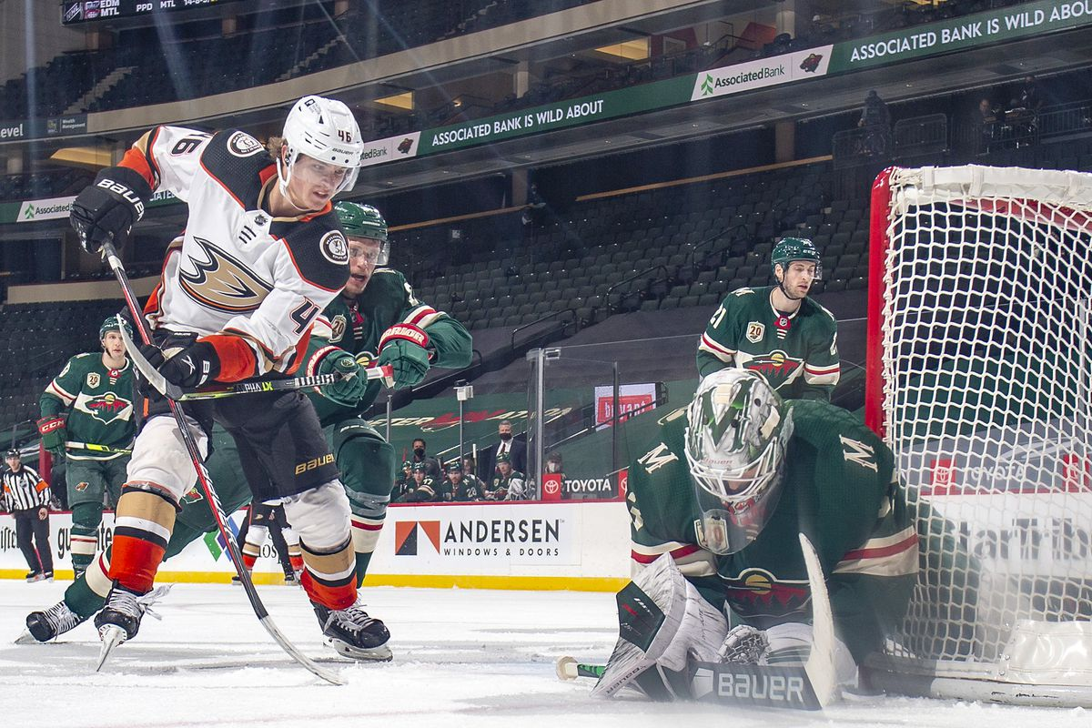 Cam Talbot #33 of the Minnesota Wild defends against Trevor Zegras #46 of the Anaheim Ducks during the game at the Xcel Energy Center on March 22, 2021 in Saint Paul, Minnesota.
