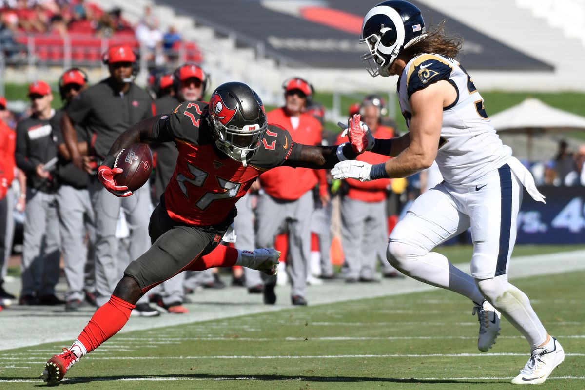 Tampa Bay Buccaneers running back Ronald Jones stiff arms Los Angeles Rams outside linebacker Clay Matthews on a third quarter running play at Los Angeles Memorial Coliseum.