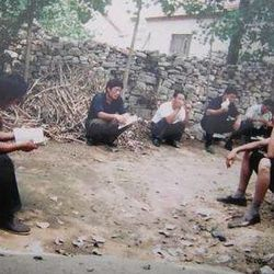 This undated handout photo provided by the China Aid Association is said to show guards outside blind Chinese legal activist Chen Guangchen's home in China. Chen, a well-known dissident who angered authorities in rural China by exposing forced abortions, made a surprise escape from house arrest on April 22, 2012, into what activists say is the protection of U.S. diplomats in Beijing, posing a delicate diplomatic crisis for both governments.