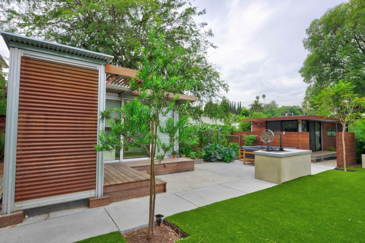 Exterior of prefab home in a yard.