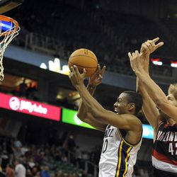 Utah Jazz point guard Alec Burks (10) grabs a rebound in front of Portland Trail Blazers center Robin Lopez (42) in the second half of a game at the Energy Solutions Arena on Wednesday, October 16, 2013.