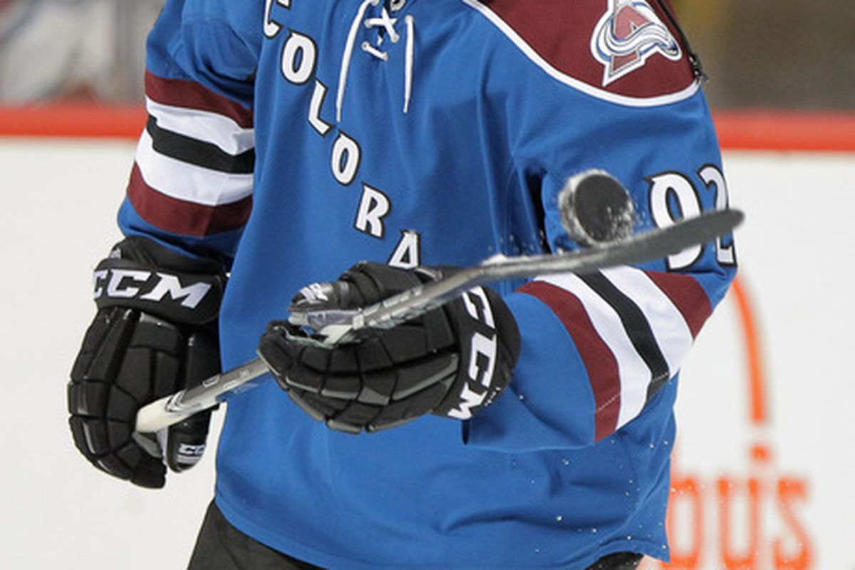 DENVER, CO - NOVEMBER 23:  Gabriel Landeskog #92 of the Colorado Avalanche jugggles the puck as he warms up prior to facing the Vancouver Canucks at the Pepsi Center on November 23, 2011 in Denver, Colorado.  (Photo by Doug Pensinger/Getty Images)