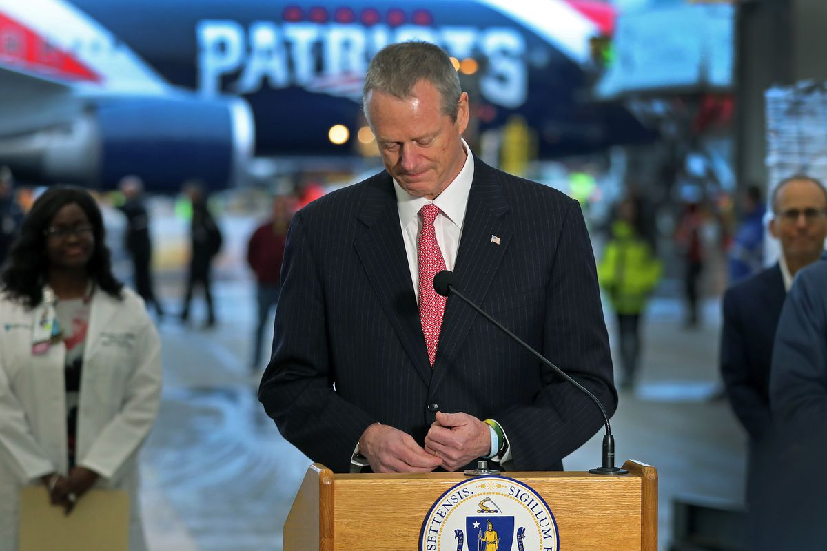 Massachusetts Governor Charles Baker gives an emotional speech and appears on the verge of tears as he thanked the Kraft family at the start of his remarks after a New England Patriots jet arrived at Logan Airport in East Boston on Apr. 1, 2020 after flying from China with a massive shipment of over one million N95 masks. They will be used in Boston and New York to help fight the spread of the coronavirus. Part of the shipment is driven into a hanger after being off loaded from the plane.