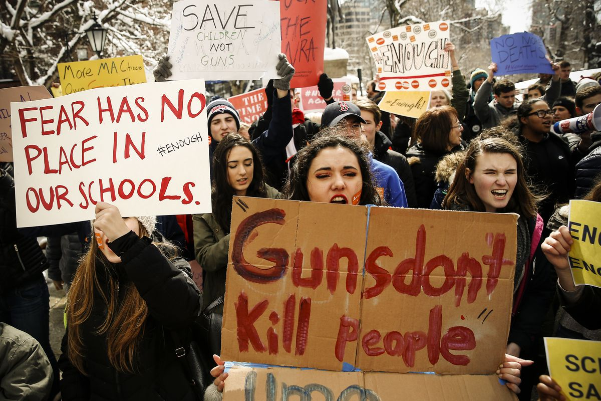 March 14: Nicole Rivera, 14, a Freshman at Arlington High School, center, rallies with other students in front of the Massachusetts State House in Boston to demand action on gun violence as part of a nationwide school walkout.  (Jessica Rinaldi/The Boston