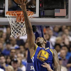Golden State Warriors' Jeremy Tyler (3) attempts a reverse layup against the Dallas Mavericks in the first half of an NBA basketball game Friday, April 20, 2012, in Dallas.