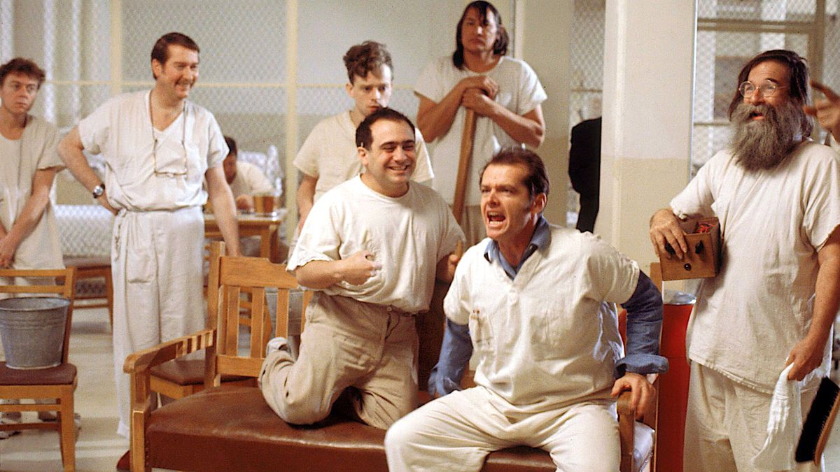 Jack Nicholson, dressed in white in a white room, yells invective at a group of eagerly listening asylum patients in One Flew Over the Cuckoo's Nest